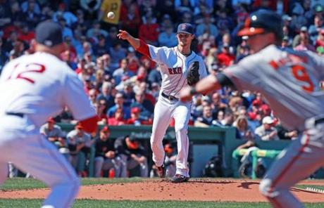 Clay Buchholz threw to Mike Napoli at first base as Nate McLouth got back to the bag safely.