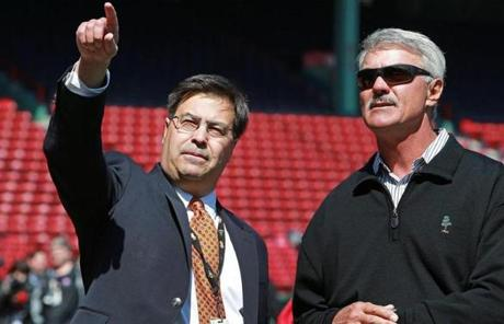 Orioles boss Dan Duquette (left), the ex-Red Sox GM, chatted with Dwight Evans before the game.
