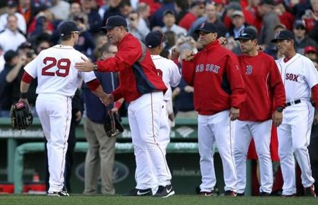 Red Sox manager John Farrell congratulated Daniel Nava after the
