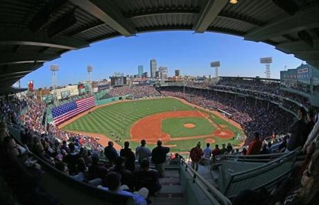 Fenway Park was packed for the home opener against the Orioles under blue skies.