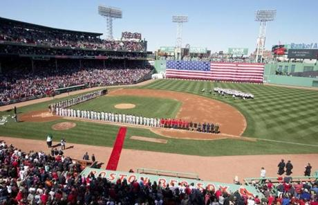 The Red Sox and Orioles lined the field prior to the home opener at Fenway Park.
