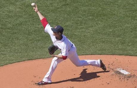 Clay Buchholz threw a pitch in the first inning as the Red Sox took on the Orioles in the home opener at Fenway.