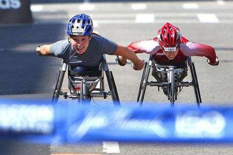 April 16, 2012: Woman's wheelchair winner (left) Shirley Reilly neared the tape followed close by 2nd place winner Wakako Tsuchida. The mid-80s temperature didn't bother the native Alaskan as she lived and trained in Arizona. Reilly's winning time of 1:37:36 was just one second ahead of Tsuchida who had won the previous five Boston Marathon races.