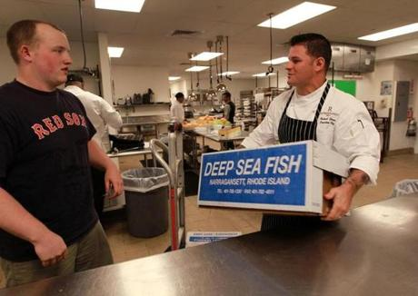 Sam Brown (left) of Wild Rhody, which delivers fresh fish, makes a delivery to 606 Congress executive chef Rich Garcia.