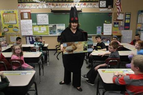 Deirdre Arvidson, a public health nurse with the Barnstable County Department of Health and Environment,  talked with third-graders at the Forestdale School while dressed in a giant tick costume.