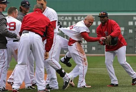 Shane Victorino nearly has his shirt ripped off after getting the winning hit Saturday.