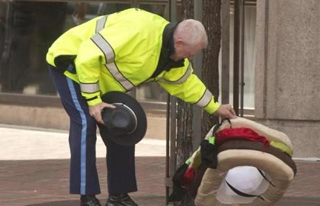 A State Police officer inspected a suspicious package on Stuart Street.
