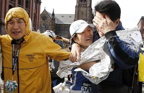 A runner, center, reunited with loved ones near Copley Square.