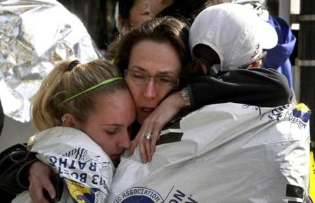 Katherine Swierk (left) hugged her aunt Terry Days (center) and friend Jocelyn Cacio near Copley Square.