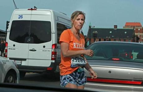 A Boston Marathon runner wandered through traffic at Boylston Street and Massachusetts Avenue.