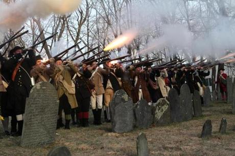 April 15, 2013-LEXINGTON--- PATRIOTS' DAY LEXINGTON, MA -- After re-enactment Minute Men fire guns in honor of those fallen during the battle of Lexington at the Old Burying Ground in Lexington. (globe staff photo: Joanne Rathe The Boston Globe metro )