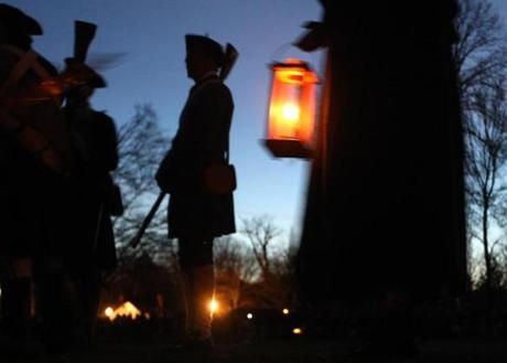 April 15, 2013-LEXINGTON--- PATRIOTS' DAY LEXINGTON, MA -- Re enactors wait in the pre dawn on the Battle Green for the 238th Anniversary re-enactment of the first day of the American War for Independence. (globe staff photo: Joanne Rathe The Boston Globe metro )