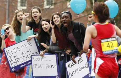 Students show support — and affection — for runners at Wellesley College.