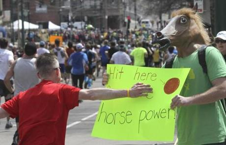 Chris Mullen of Waltham gave runners an equestrian boost on Chestnut Hill Avenue.
