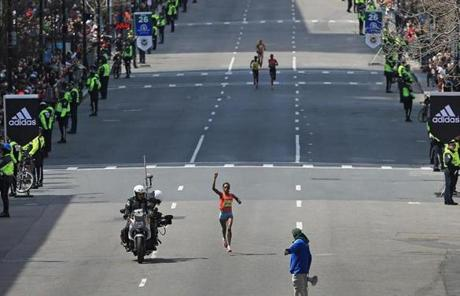 Rita Jeptoo was alone on her way to the finish line.