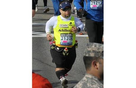 John Young of Salem, one of two dwarfs registered to run the marathon, at the start of the Mobility Impaired Program.