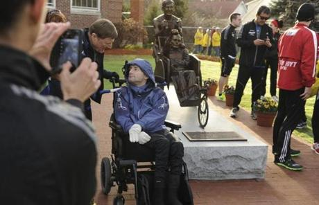Dick Hoyt (left) and his son, Rick, posed for photos by the statue of them in Hopkinton before the start of the 177th Boston Marathon.