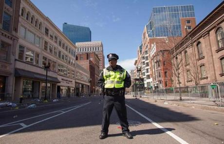 A Boston Police officer stood on Boylston Street on Tuesday.