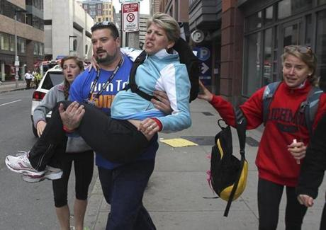 Former Patriots offensive lineman Joe Andruzzi carried an injured woman away from the scene.