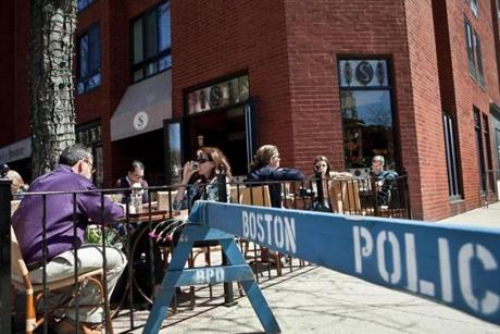 Patrons filled patio tables at Stephanie's on Newbury as the Back Bay restaurant reopened Wednesday to a bustling lunch crowd.