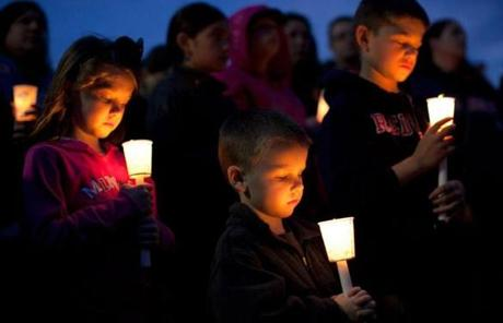 Emily Gillis, 7, her brother Conor, 4, of Dorchester, and their cousin Benjamin McCormick, 8, of Milton attended a vigil for blast victim Martin Richard at Garvey Park in Dorchester.