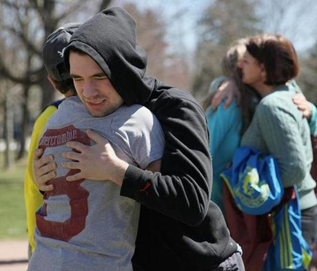 Alan Biggers, 14, embraced Ryan Lynch during a vigil for the Boston Marathon in Hopkinton.