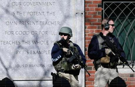US Marshals stood guard outside Boston's Moakley Federal Courthouse after if was evacuated Wednesday afternoon.