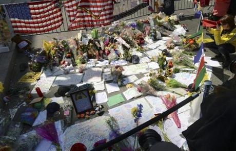 The memorial at the barricade at Boylston and Berkely streets grew to include more flowers, medals, and stuffed animals.