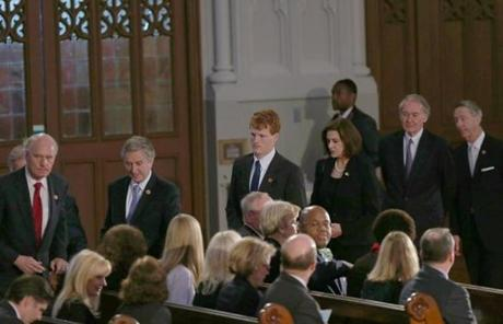 Entering the service are Massachusetts US representatives William Keating, John Tierney, Joseph P. Kennedy III with Vicki Kennedy, the widow of late Senator Edward M. Kennedy, Edward Markey and Stephen Lynch.