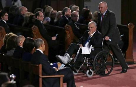 Boston Mayor Thomas M. Menino, who fractured his ankle last week, passed the Obamas as he was wheeled into the church.