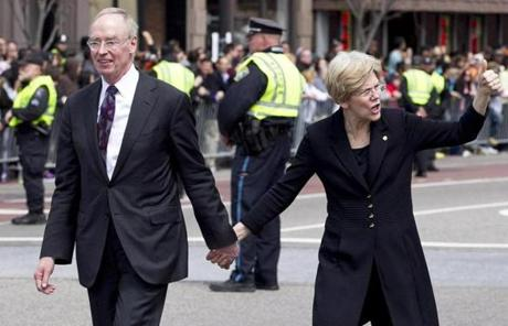 US Senator Elizabeth Warren left the cathedral after the service with her husband, Bruce Mann.
