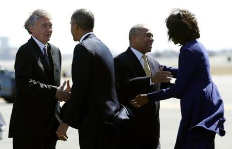 President Obama greeted Representative Edward Markey as Michelle Obama greeted Governor Patrick at Logan Airport.