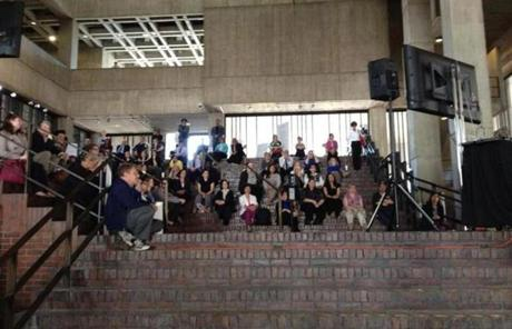 Business at Boston City Hall came to a halt as employees watched the service.