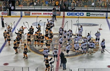 After the game, which the Sabres won in a shootout, both teams took to center ice to salute the fans.