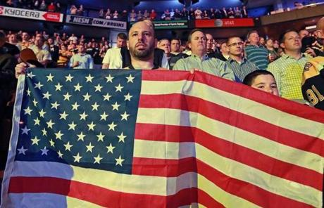 Mike Adler displayed this American flag during a moment of silence before the game.