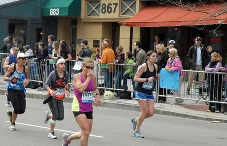 The suspects were photographed near the finish line.