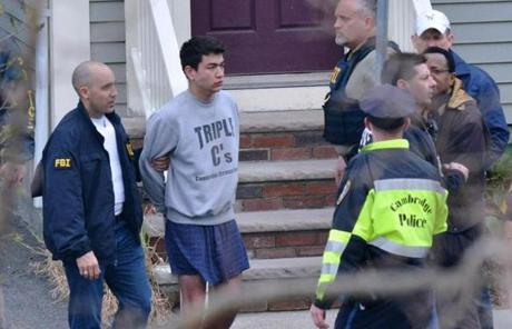 Officers took two men into custody at Norfolk Street in Cambridge Friday morning.