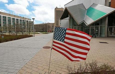 An American flag fluttered at the scene of the murder of MIT police officer Sean Collier.