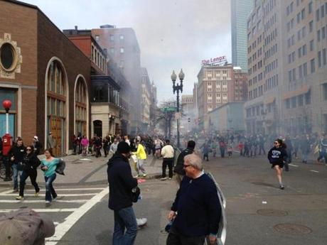 Dzhokhar A. Tsarnaev (left, in white hat) is shown walking away after the Marathon bombings on Monday.