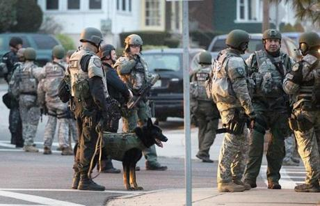 Police and with K-9 units prepared to patrol a section of Watertown.