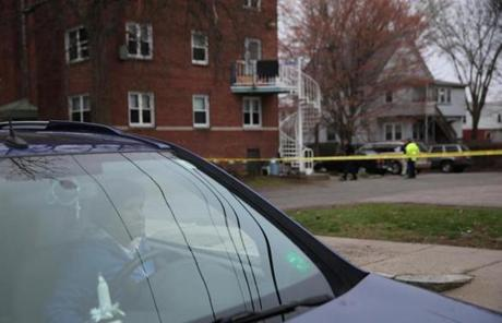A neighbor watched police activity from her car in Watertown.