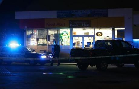 A convenience store at Memorial Drive and River Street in Cambridge became a crime scene after two men carjacked an SUV at gunpoint.