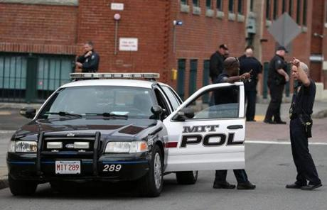 A MIT police officer stood by his cruiser Friday. Late Thursday,  MIT officer Sean Collier was shot and killed.