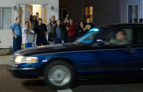 Residents along Arsenal Street in Watertown cheered police after the capture of Dzhokhar A. Tsarnaev.