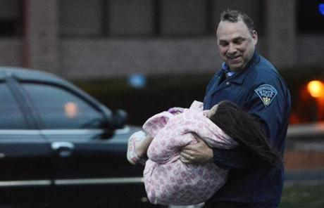 An officer evacuated a child away from an area where a suspect was hiding on Franklin Street in Watertown.