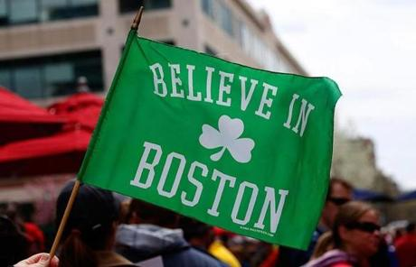 Fans held a flag outside Fenway Park before today's game.