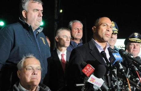 Governor Patrickspoke after Tsarnaev's capture, flanked by Mayor Meninoand other officials.