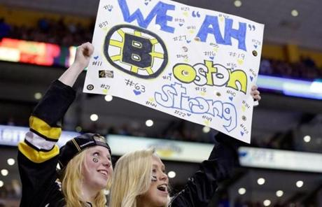 Fans held signs at TD Garden during the game against the Penguins.