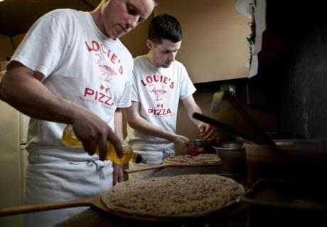 Randy Macinanti, a grandson of Louie, and Colin McDonough making pizzas in the kitchen.