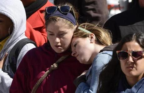 Heather Orr, left, and Sarah Orr, sisters from Maine, embraced at the memorial.